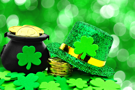 St Patricks Day Pot of Gold, hat and shamrocks over a green background