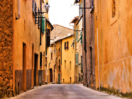 narrow street: Rustic medieval street in a town in Tuscany, Italy