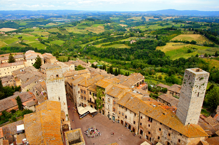 the tuscan: Aerial view over the town of San Gimignano, Tuscany, Italy