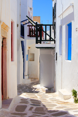 Whitewashed street in the old town of Mykonos, Greece  photo