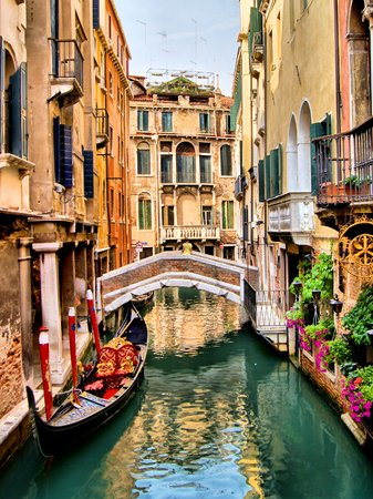 Scenic canal with gondola, Venice, Italy  photo