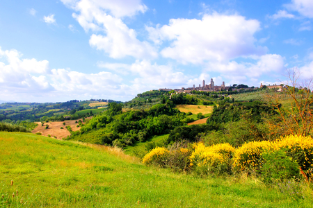Countryside of Tuscany towards the medieval town of San Gimignano, Italy photo