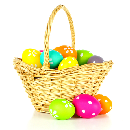 flower baskets: Easter basket filled with colorful eggs over a white background Stock Photo