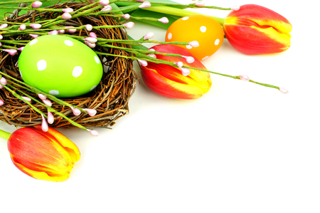 Easter egg and nest with tulips forming a corner border over white Stok Fotoğraf - 26272797