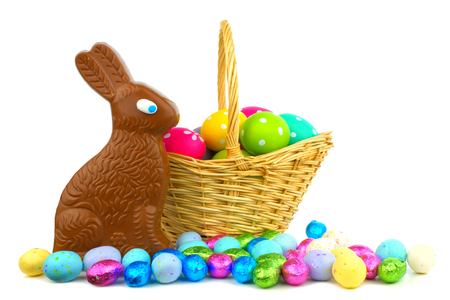 Chocolate bunny and candy with Easter basket over white