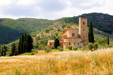 montalcino: Abbey of Sant Antimo among the hills of Tuscany, Italy Stock Photo