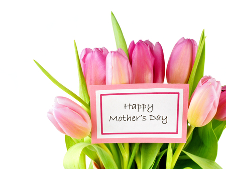 Happy Mother s Day card among a bouquet of pink tulips