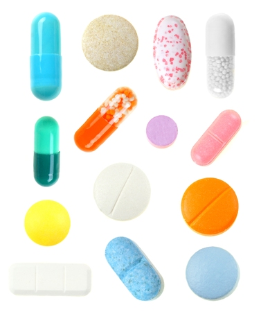 Group individually isolated pills over a white background photo