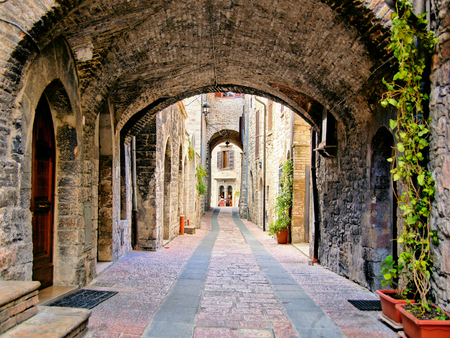 quaint: Arched medieval street in the town of Assisi, Italy Stock Photo
