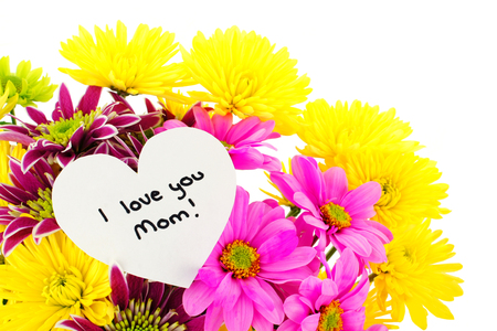 I love you Mom card amongst a bouquet of colorful flowers photo