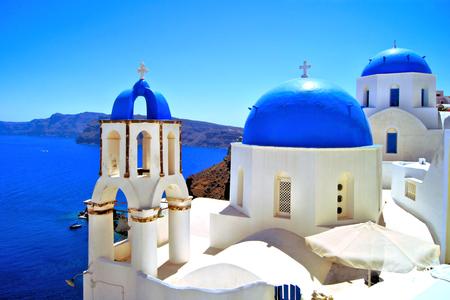 Beautiful blue dome churches of Santorini, Greece photo