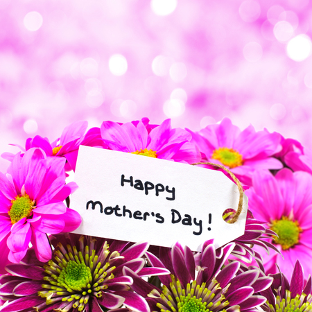 twinkling: Happy Mothers Day tag amongst a bouquet of flowers with twinkling pink
