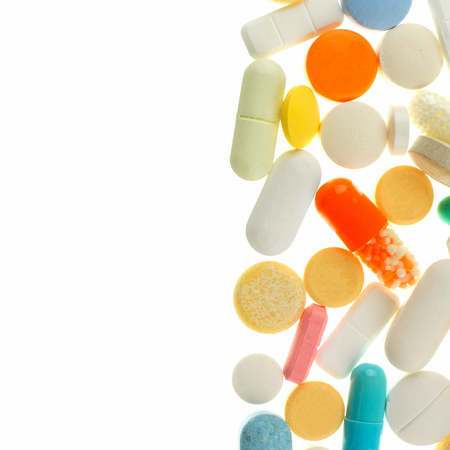 Vertical border of assorted medications isolated on white