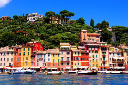 riviera: Colorful houses of the harbor at Portofino, Italy with boats