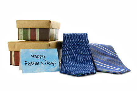 Happy Fathers Day card with gift boxes and ties over white