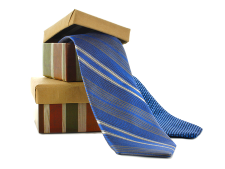 Fathers Day gift boxes and ties over white
