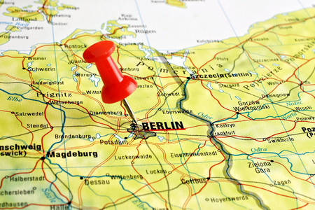 Close up of Berlin on a map with red pin photo