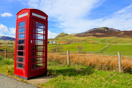 Classic red British phone booth in the countryside of the Isle of Skye, Scotland photo