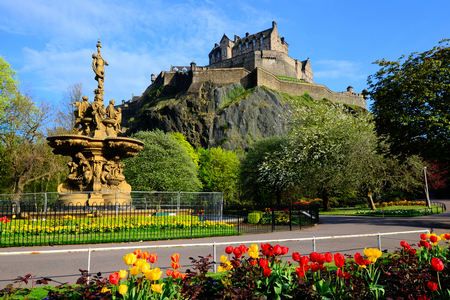 Edinburgh Castle view from Princes Street Gardens with fountain and flowers