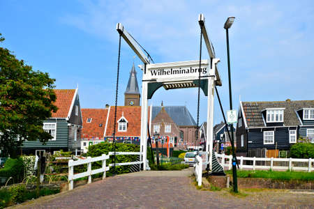 Traditional Dutch fishing village of Marken with lifting bridge photo