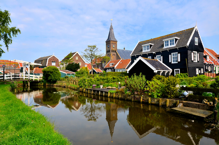 marken: Picturesque Dutch fishing village of Marken with canal and reflections Stock Photo