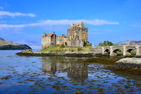 Iconic Eilean Donan Castle of Scotland with reflections
