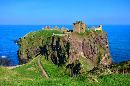 Scenic ruins of Dunnottar Castle along the coast of Scotland Editorial