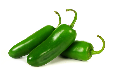 hot peppers: Group of jalapeno peppers isolated on a white background Stock Photo