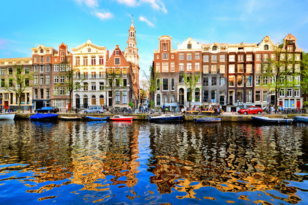 amsterdam canal: Canal houses of Amsterdam at dusk with vibrant reflections, Netherlands Stock Photo