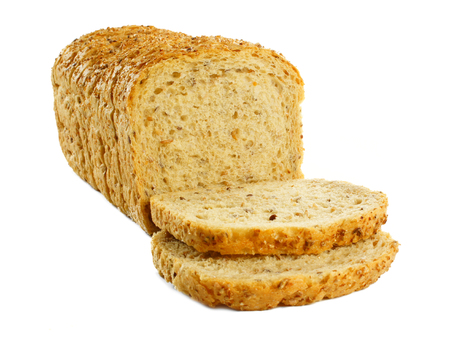 toppled: Sliced loaf of bread with toppled pieces over a white background