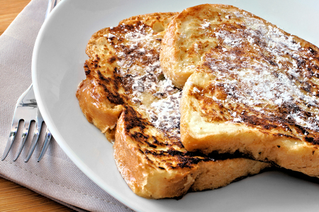 french bread: Plate of French Toast with powdered sugar Stock Photo