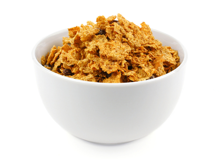 bowl of cereal: Bowl of bran flakes cereal on a white