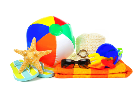 Group of colorful beach items over a white  photo