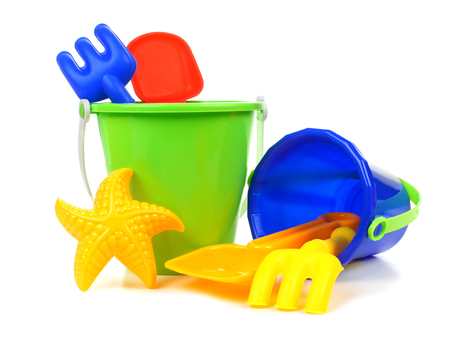 Toy sand pails and shovels over a white  photo