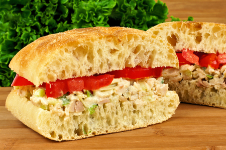 Chicken salad and tomato sandwich on a ciabatta bun photo
