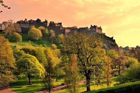 princes street: View of Edinburgh Castle and Princes Street Gardens at sunset