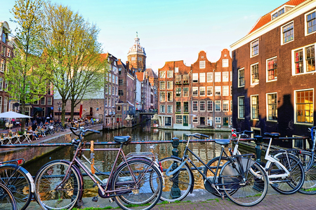 Bicycles along the canals of Amsterdam, Netherlands photo