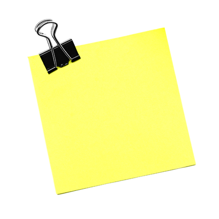 Single yellow note with paper clip isolated on white photo