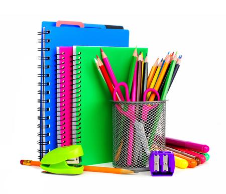 Groep kleurrijke schoolschriften en benodigdheden op een witte achtergrond Stockfoto
