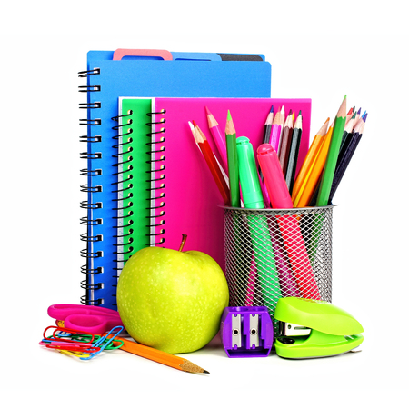 Group of colorful school notebooks and supplies over a white background photo