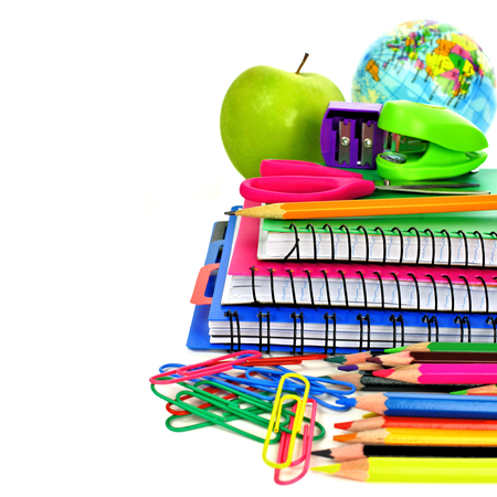 office stapler: Group of colorful school supplies forming a border over a white background