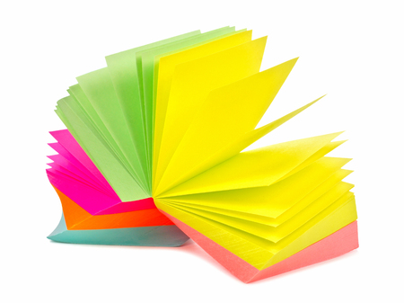 Note pad of sticky notes open like an fan isolated on white photo