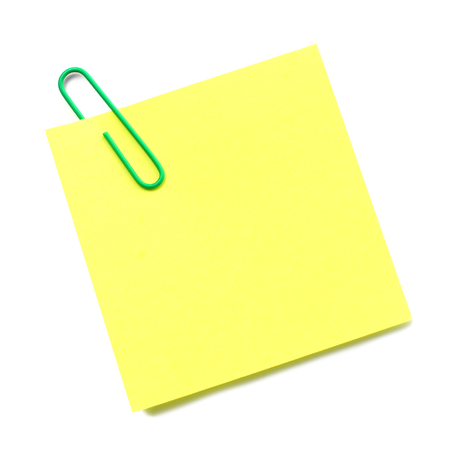 sticky notepaper: Blank sticky note with green paper clip isolated on white