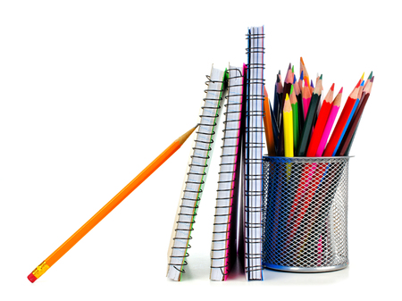 colored school: Standing school notebooks with pencils over a white background