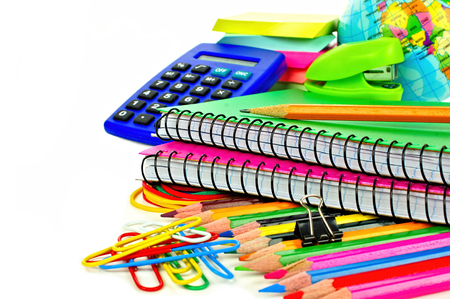 Group of colorful school supplies over a white background photo