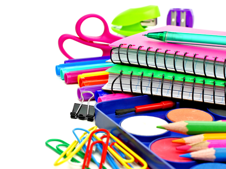 office stapler: Group of colorful school supplies over a white background Stock Photo