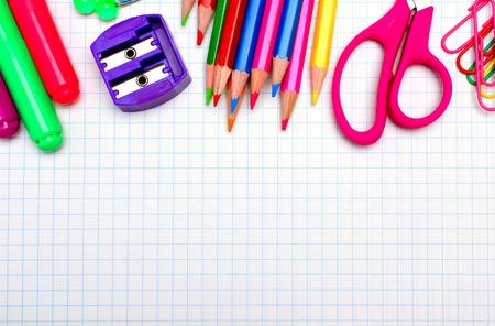 Colorful útiles escolares frontera sobre papel de gráficas Foto de archivo - 30090918