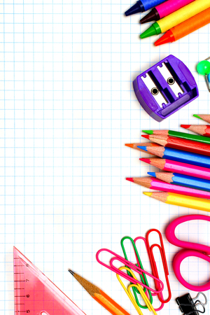 graphing: Colorful school supplies corner border over graphing paper