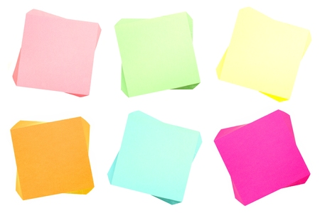 Six pads of blank sticky notes of various colors isolated on white photo