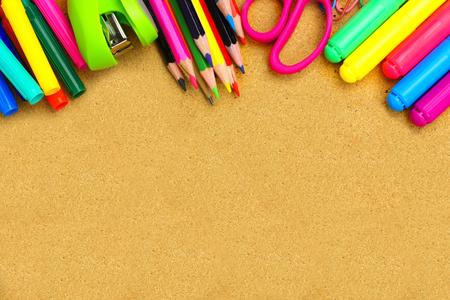 bulletin board: Colorful school supplies border on a bulletin board